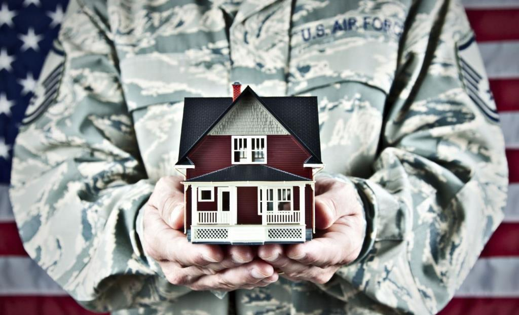 Image of veteran holding a toy home