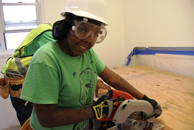 YouthBuild Participant at work with saw